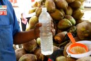 Vendor Filling Bottle With Coconut Water    Healthy Natural Drink...